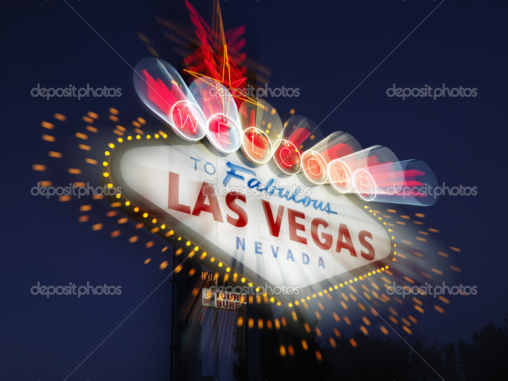 Welcome to Fabulous Las Vegas Nevada sign with motion zoom blur at night. Horizontally framed shot. — Stock Photo #9227046