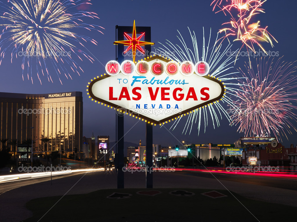 Lighted sign reading Welcome to Fabulous Las Vegas Nevada with fireworks in background. Horizontally framed shot. — Stock Photo #9227053