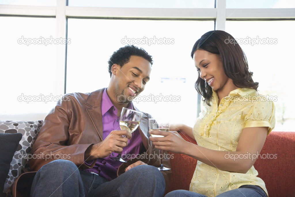 African American couple toasting with wine glasses. — Stock Photo #9227337
