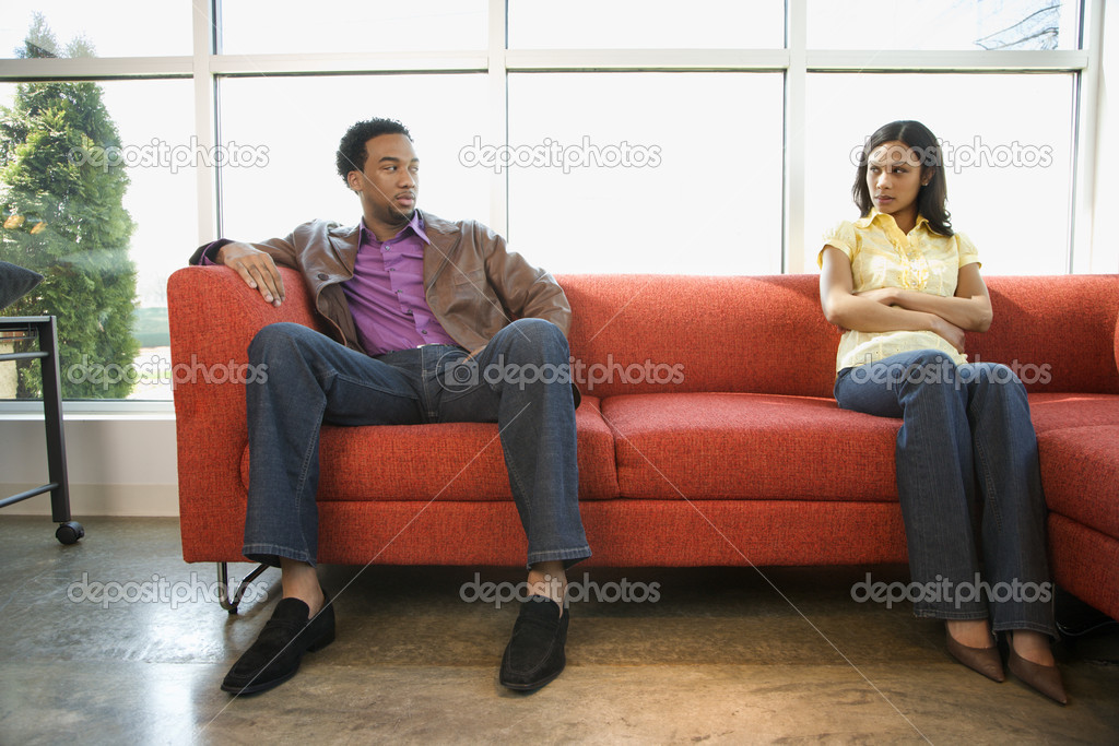 African American couple sitting on couch in dispute. — Stock Photo #9227339
