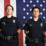 Policewomen and flag. — Stock Photo