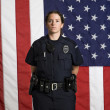 Policewoman and flag. — Stock Photo