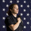 Stock Photo: Patriotic policewoman.