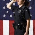 Policewoman saluting. — Stock Photo