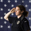 Stock Photo: Policewoman saluting.