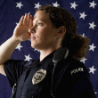 Policewoman saluting. — Stock Photo