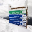 Snow covered sign. - Stock Photo