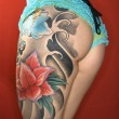 Tattooed womans leg and derriere — Stockfoto