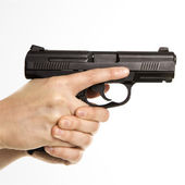 Female holding handgun. — Stock Photo