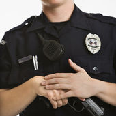 Policewoman with gun. — Stock Photo