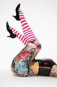 Tattooed womans legs — Stock Photo