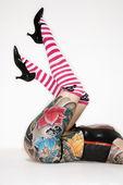 Tattooed womans legs — Stock Photo