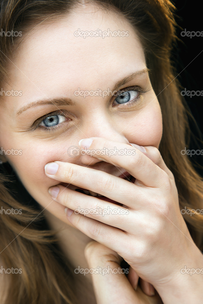Close up portrait of young adult caucasian female laughing with hand over mouth. — Stock Photo #9239887