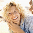 Smiling woman on beach — Stock Photo