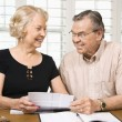 Mature couple with bills. — Stock Photo