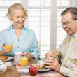 Royalty-Free Stock Photo: Mature couple eating breakfast.