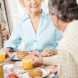 Mature couple eating breakfast. — Stock Photo #9248623