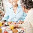 Stock Photo: Mature couple eating breakfast.