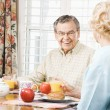 Mature couple eating breakfast. — Stock Photo #9248625