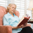 Mature woman reading. — Stock Photo