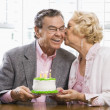 Постер, плакат: Mature couple with cake