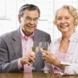 Mature couple with wine. — Stock Photo