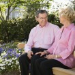 Mature couple on bench. - Stock Photo