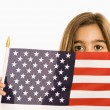 Royalty-Free Stock Photo: Girl holding American flag.