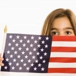 Girl holding American flag. — Stock Photo