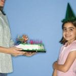 Girl getting birthday cake. — Stock Photo