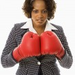 Stock Photo: Businesswoman in boxing gloves.