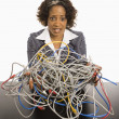Businesswoman with computer cords. - Stock Photo