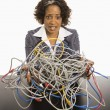 Businesswomwith computer cords. — Stock Photo #9249816