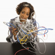 Businesswoman with computer cords. — Stock Photo