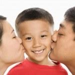 Parents kissing son. — Stock Photo