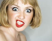 Woman looking crazy. — Stock Photo