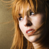 Windblown woman looking to side — Stock Photo