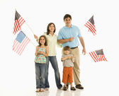 Family holding American flags. — Stock Photo