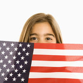 Girl holding American flag. — Stockfoto