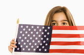 Girl holding American flag. — Stock Photo