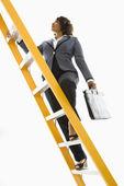 Businesswoman climbing ladder. — Stock Photo