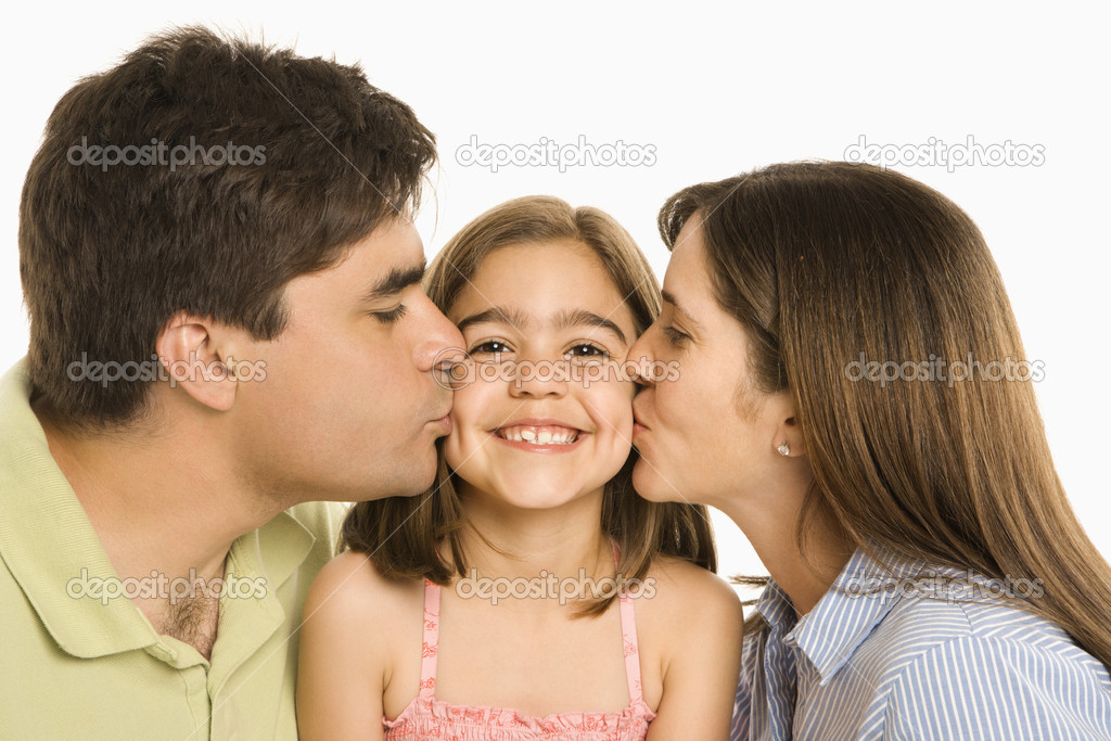 Mother and father kissing smiling daughter on cheek. — Stockfoto #9249336