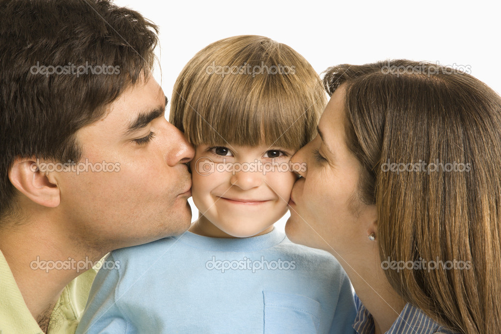 Mother and father kissing son on opposite cheeks. — Stock Photo #9249340