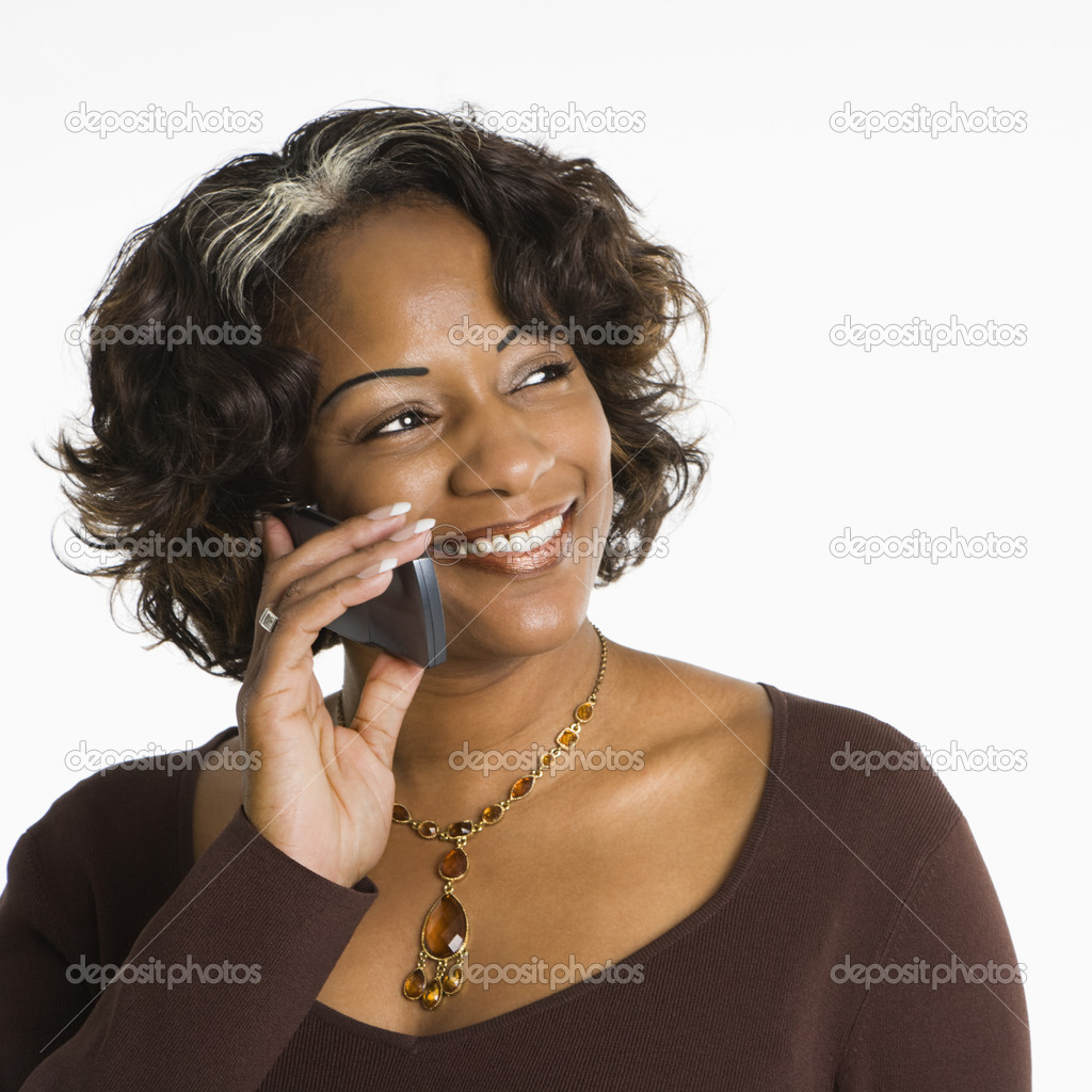Portrait of woman holding telephone to ear and smiling. — Stock Photo #9249731