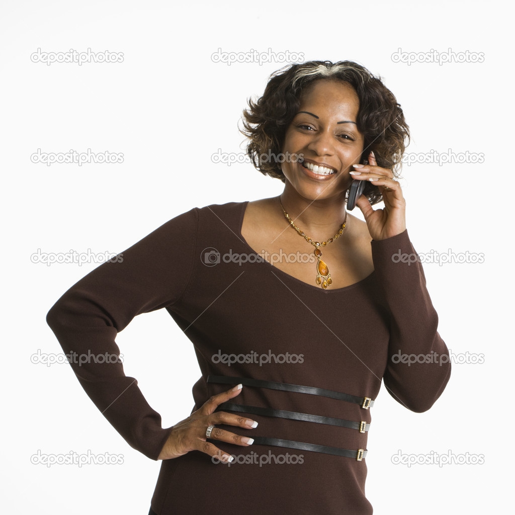 Portrait of woman holding telephone to ear and smiling. — Stock Photo #9249737