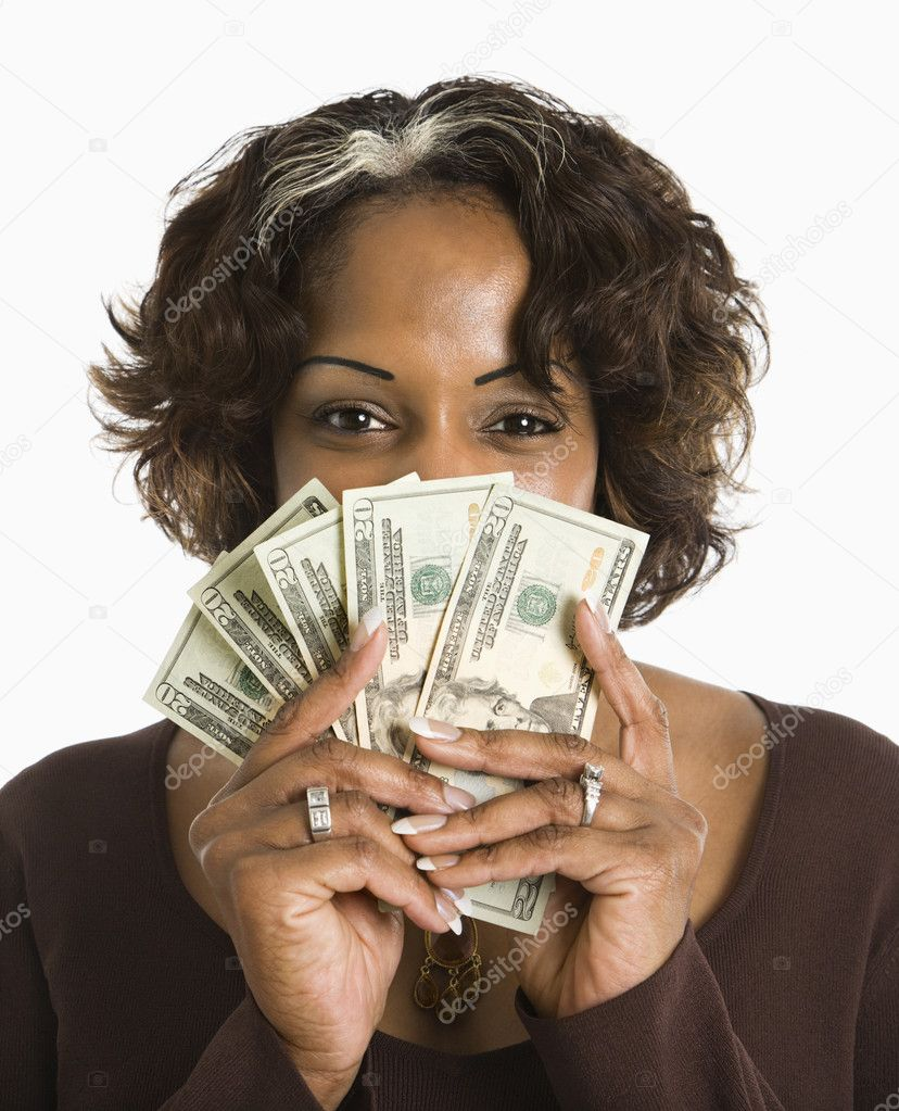 Portrait of woman holding twenty dollar bills in hand.  Stock Photo #9249746
