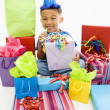 Boy with gifts. — Stock Photo