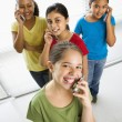 Girls on cell phones. - Stock Photo