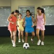 Stock Photo: Girls playing soccer.