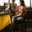 Couple toasting at bar. - Stock Photo